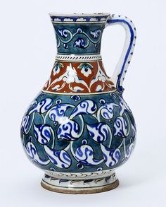 Jug with red band around neck and floral design on green body, Turkey (probably Iznik), ca. 1590-1600.