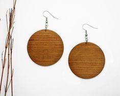Wood earrings with the singular beauty of cherry timber. Wood Earrings, Circle Earrings, Chandelier Earrings, Handmade Chandelier, Modern Chandelier, Circle Shape, Wooden Jewelry, Wood Grain, Crochet