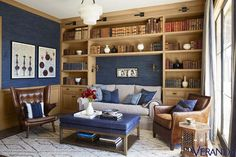 Linen walls, done up in C&C Milano fabric, and curtains from Ralph Lauren Home add a luxurious element to this reading room.   - Veranda.com
