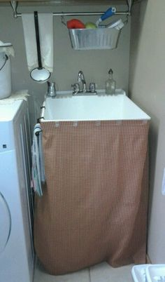 Use 3m Clips Attached To The Laundry Utility Sink And Slip A Fabric Skirt  Into The