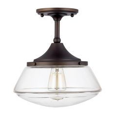 This semi-flush ceiling light creates the illusion of greater depth in your decor without occupying a large amount of headroom. Finished in rich, burnished bronze, the hardware showcases a clear and elegant glass shade.
