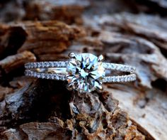 This is lovely too. (14k White gold - Diamond Engagement Ring - Halo at the base - UNIQUE - Pave - Bp022. $6,500.00, via BeautifulPetra on Etsy.)