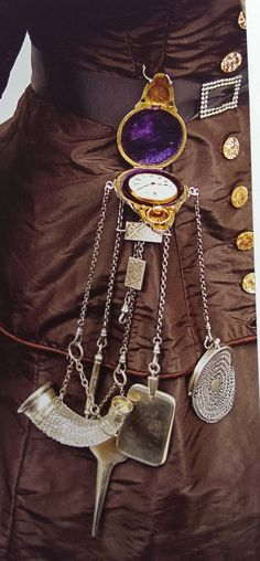 1870s chatelaine that holds a watch in its case, with all its tools.