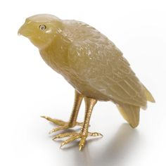A FABERGÉ CARVED AGATE FIGURE OF A FALCON WITH GOLD LEGS AND DIAMOND EYES, ST. PETERSBURG, CIRCA 1900 depicted standing with folded wings, realistically modeled with chased gold feet and diamond-set eyes