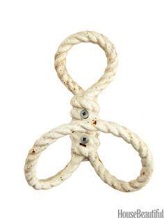 Wall hook by Homart. housebeautiful.com. #nautical #hooks #antiquewhite