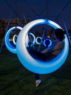 Swing Time is an interactive playscape composed of 20 illuminated ring-shaped swings design by Höweler + Yoon Architecture studio.