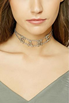 """A high-polish chain choker featuring old English """"Babe"""" charms and a lobster clasp closure."""