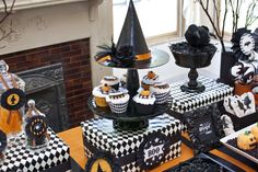 love the witch's hat cake stand topper. love the wrapped boxes as well...great touches that are inexpensive