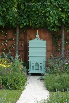 What if someday Jason and I have a farm we could raise bee's in gorgeous beehives like this.  I think I would like it!