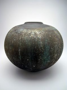 "Harvey Sadow's work looks like coil to me, but his artist statment says he ""re-throws"" pots, among other techniques. His pots are in the High Museum-Atlanta and the White House Collection-Washington DC. Born 1946, this artist enjoys living in Florida. ,,. So do I! American Artist, Harvey Sadow"