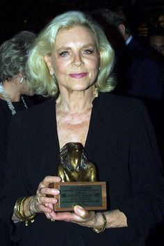 Lauren Bacall receives a lifetime achievement award at a Tony awards dinner in 2001
