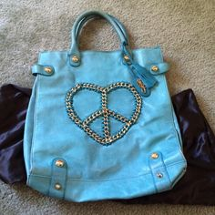 Betsey Johnson Turquoise Leather Bag Sewn chain in heart/peace sign design, turquoise blue leather, signs of wear only on handles and a little bit on corners, comes with original dust bag, great unique item for any time of year, NO TRADES Betsey Johnson Bags