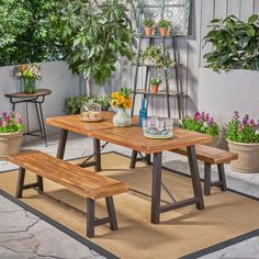 Enjoy al fresco meals on the patio or porch with this essential three-piece picnic table set! Crafted of solid acacia wood in a natural teak finish, the chunky rectangular tabletop features a planked design for a rustic appearance.
