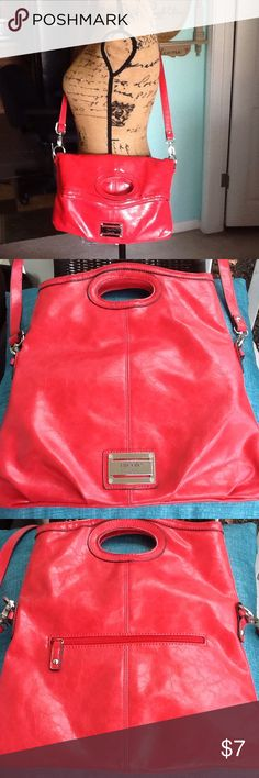 Nicole Miller handbag/cross body I would call this color a burnt red, can be carried as shoulder,cross body, or handbag,in great condition. Nicole by Nicole Miller Bags Crossbody Bags