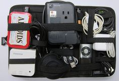 The Grid It - holds lots of electronics you want to carry along with cords - chargers - batteries - etc.