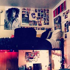 I like the mixture of posters and photos and then the cute lights attached to the bed.