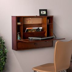 Enhance your home office with this wall-mount laptop desk. This attractive brown mahogany-finished desk features a fold-down tabletop, storage cubbies, and a convenient drawer. The roomy writing surface allows for work to get done comfortably. Table Ikea, A Table, Floating Wall Desk, Floating Globe, Murphy Desk, Wall Mounted Desk, Mounted Tv, Folding Desk, Desks For Small Spaces