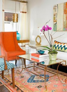 Home Chic Raleigh: Figuring Out My Living (room) Style - Persian rug, orange chair, orange living room, bright living room, eclectic living room, gold accents, abstract art, orange turquoise gold living room, gold lamp, gold coffee table, bold living room, orange is the new black