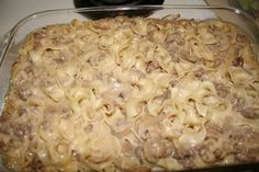 Ingredients :  1 can Cream Of Mushroom Soup  1 can Cream Of Chicken Soup 8 oz sour cream  12 oz uncooked egg noodles  1 pound ground beef  1/3 cup Parmesan cheese, grated    Directions :      Brown ground beef and drain.  Boil noodles until tender