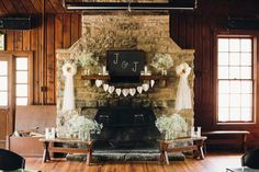 Fall colors - Baby's Breath - Banner - Rustic stone fireplace - Indoor wedding - Wyman Center - Oldani Photography