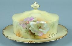 "RS Prussia Covered Butter Dish, 3.5""h. x 7.75""d.,  three floral designs on cover, shadow leaves on dish. All yellow ground with gold edging"