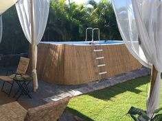 Bamboo covering for above ground swimming pool. ideas above ground cheap diy How to de-boring the outside of an above-ground pool Above Ground Pool Landscaping, Backyard Pool Landscaping, Above Ground Swimming Pools, Small Backyard Pools, Swimming Pools Backyard, Swimming Pool Designs, In Ground Pools, Intex Above Ground Pools, Pool Fence