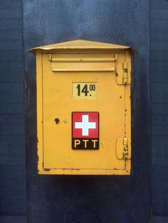 Official Swiss post office box attached to the facade of a building in Manhattan, NY... © 2006 - Clarke L. Smith www.clarkesmith.com