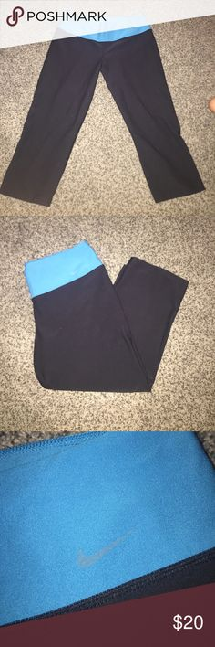Nike Leggings A pair of black Capri Nike leggings with a blue/teal waistband. No rips or pilling anywhere; almost like new. Nike Pants Leggings