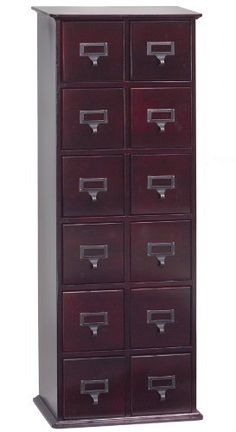"""Cherry Leslie Dame Tall CD Media Storage Cabinet in Oak by Leslie Dame. $199.95. Cherry stained hardwood finish. Holds 228 CDs or 96 DVDs or 48 VHS Videocassettes or any combination of these.. Solid Wood. Assembled Dimensions: 40"""" H x 15 1/2"""" W x 9 3/8"""" D. Fully Assembled. Features:  Solid Oak cabinet available in multiple finishes The vintage style drawer pulls also come with labels to help organize your collection. Drawers made deep to hold all your DVDs  Comple..."""