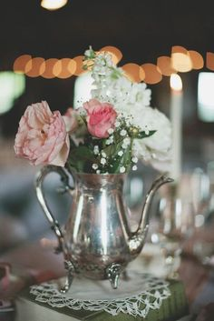 Incorporate the tea theme into your tablescape with a vintage silver teapot with fresh flowers. Source: Wedding Chicks #vintageweddings #teatheme #vintagesilver