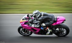 Sammi Tasker on her trademark pink Suzuki.