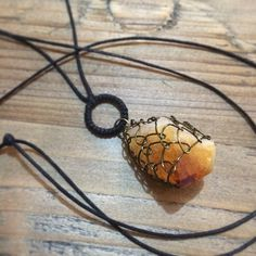 "@Somsri Saelee's photo: ""Wire woven citrine (yellow quartz) necklace on long leather cord."" #jewellery #handmade #jewelry #necklace #crystals #somsri #gemstone #citrine #leather #orange #orangequartz #quartz"