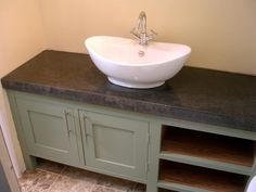 Arnold's Kitchens pride ourselves in creating unique, bespoke kitchens, interiors and polished concrete worktops for people who want distinction and individuality. Bathroom Worktops, Concrete Kitchen, Hurricane Lamps, Bespoke Kitchens, Polished Concrete, Work Tops, Cornwall, Bathroom Ideas, Sink