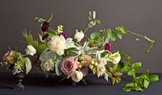The arrangement above is as  sumptuous as a Dutch flower painting, but these botanical marvels—a mix of air  plants, pine branches, peonies, roses, and ranunculus—are the real thing as  styled by designer Bridget Vizoso