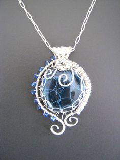 Wire wrapped jewelry, handmade wire wrapped jewelry, Blue glass pendant, handmade wire wrapped pendant. $35.00, via Etsy.
