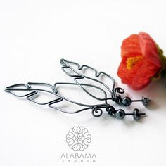 Silver feathers  original asymmetrical earrings by AlabamaStudio