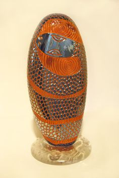"John Brekke, ""Icon (metallic snake),"" blown, carved glass, http://www.morganglassgallery.com/imagepages/Brekke_JBA-7_Icon_Metallic_Snake_Orange.htm"
