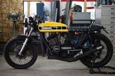 Superb 1973 RD350 cafe racer entirely rebuiltwith great care. Rebuilt: Frame - rear end plus powder coat New Stainless steel engine bolts New set of carbs - 30mm Mikuni's New Set of Uni air filters New crankshaft New pistons New Ste