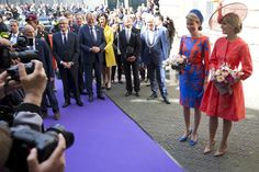 """Belgium's Queen Mathilde, second right, and Netherlands Queen Maxima, right, pose for photographers as they arrive for the opening of the """"Vormidable"""" exhibit of sculptures by Flemish artists, in The Hague, Netherlands, Wednesday, May 20, 2015. The exhibit in the city center can be seen from from May 20 till August 30, 2015. (AP Photo/Peter Dejong)"""