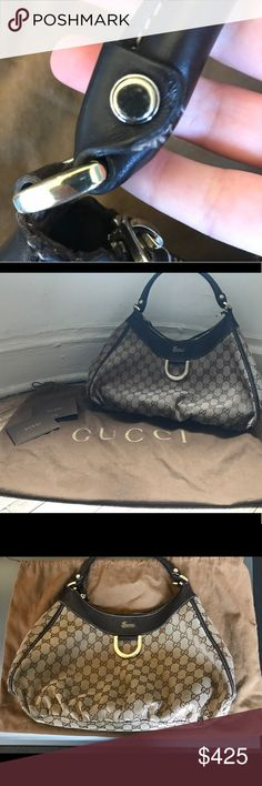 🔥Authentic Gucci🔥 Monogram D Ring Hobo Purse ‼️PRICE DROP‼️Authentic GUCCI Monogram D-Ring Hobo Bag & dust bag. Purchased at the Gucci store in the Bellagio in Las Vegas. 2 tone brown, with a dark brown leather handle and metal D-ring. There is wear and tear on the back of the bag (please see photos). There is a zippered pocket on the inside as well as a cell phone pocket (I keep my keys in it). Bag measures approx 15w x 9 tall (not including handle) and 5.5 depth. Non-smoking home. Gucci…