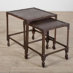 @Overstock - These nesting tables are made from recycled cold-rolled steel. Inspired by industrial shelves, the pop rivet corner braces and casters make a strong statement.http://www.overstock.com/Worldstock-Fair-Trade/Set-Of-2-Dark-Brown-Iron-Tables-India/6820234/product.html?CID=214117 $242.99