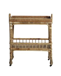 Inspired by a mid-century antique, this chic little side cart pays homage to the textural beauty of handwoven rattan. Set atop brass casters, it glides across the room with ease. Unexpected as a bedside table; perfection as a mini bar in the living or dining room.