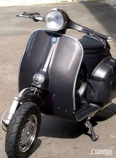 Vespa. Not a fan of the modified front fork I actually only noticed it but dooo love the gunmetal grey