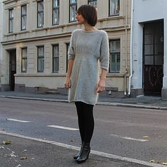 An elegant, slightly fitted around the waist by using thinner needles for the waist. The dress is lightweight, knitted in an exclusive blend of merino tweed and silk mohair.