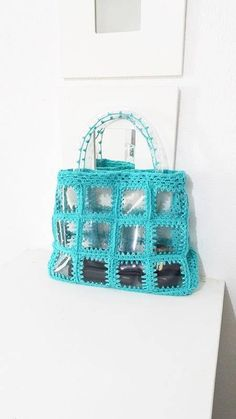 Items similar to Clear Turquoise / Vinyl Handbag with Turquoise Cotton ,Transparent plastic crochet handbag, wearable art bag,gift for her on Etsy Granny Square Crochet Pattern, Basic Crochet Stitches, Crochet Wool, Diy Crochet, Crochet Christmas Gifts, Decorated Wine Glasses, Transparent Bag, Crochet Handbags, Quilted Bag