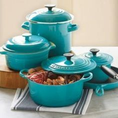 Le Cruset - love the color it totally matches my kitchen....turquoise!!  ~ I want these:)