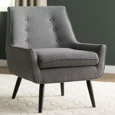 Engage your sensibilities with the organically shaped posit armchair. Posit is gracefully positioned on solid espresso stained dowel legs designed according to mid-century design practices. Whether settling in with coffee and brunch or entering a spirited discussion with friends, posit's polyester upholstery two rows of finely stitched back seat buttons and organic form ensure an eye-catching appeal at every turn. Bring depth and modernity to your contemporary living room or lounge area with…