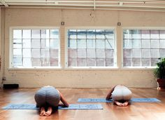 A headstand with a twist http://www.thecoveteur.com/partner-yoga-moves-sky-ting/