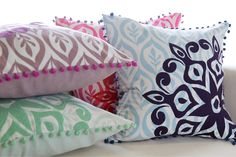 Pillows for Surya - screen printed, embroidered, and finished with pompom edging!