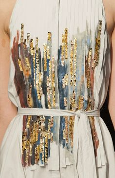 Love the detailing of this dress.